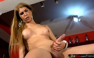 Perfect blonde t-girl strips off lingerie and strokes